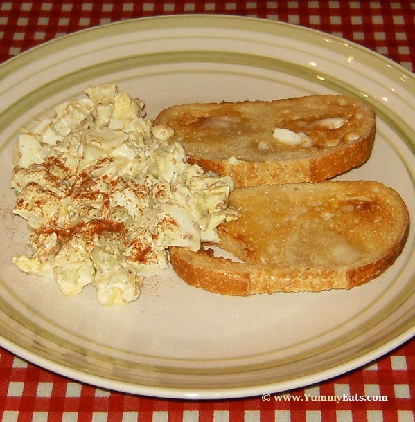 Egg Salad with buttered Sourdough Toast, plated and served.