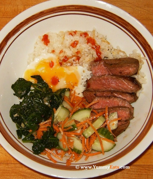 Beef Bibimbap with Crispy Rice and Sriracha - Plated recipe.