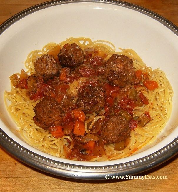 Bowl of Spaghetti and Meatballs, sauce and meatballs cooked in a Crock Pot and served over noodles.