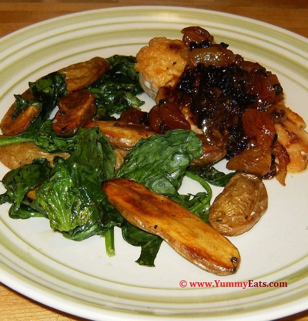 Braised Chicken, Apricots, and Currants with Roasted Fingerling Potatoes, Spinach and a sweet White Wine Sauce. Plated recipe.