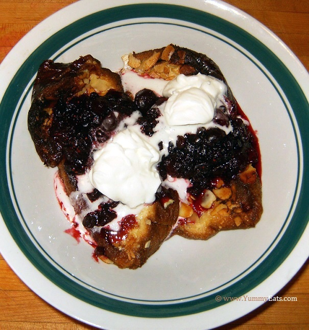 Pain Perdu with Cranberry-Currant Compote and topped with home whipped cream - Plated dessert.